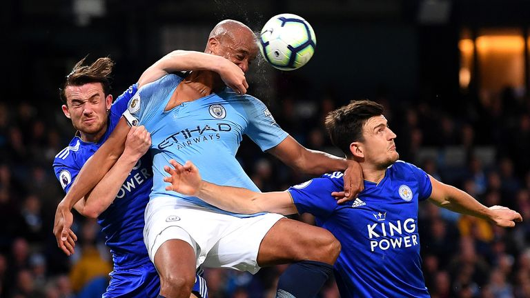 Vincent Kompany battles for possession with Ben Chilwell and Harry Maguire
