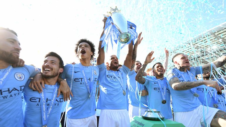 Vincent Kompany lifts the Premier League trophy after winning the title with a 4-1 victory over Brighton