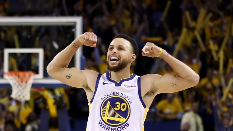 Stephen Curry flexes for the crowd after scoring in Golden State's Game 5 win over Houston