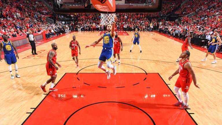 Stephen Curry scores at the rim during the Golden State Warriors' series-clinching Game 6 win over the Houston Rockets