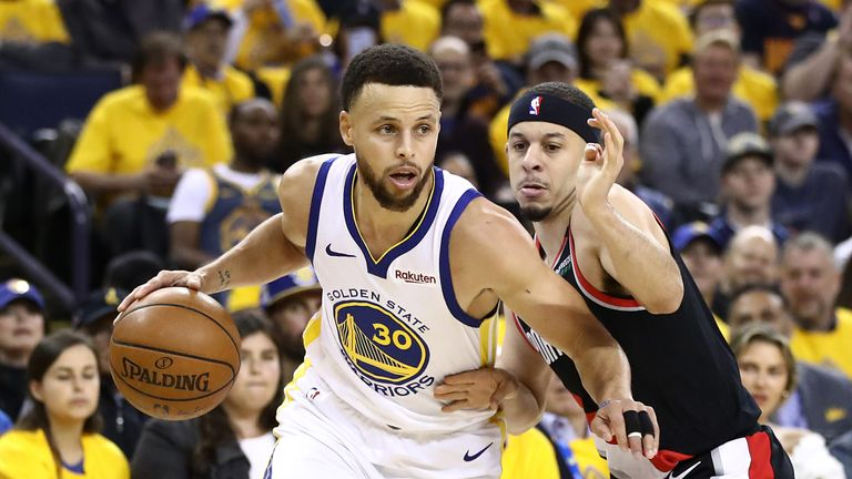 Stephen Curry attacks his brother Seth in Game 1 of the Western Conference Finals