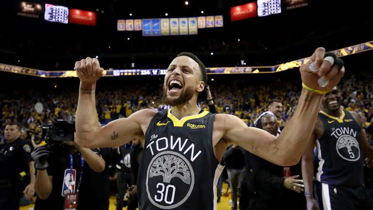An elated Stephen Curry celebrates Golden State's 114-111 Game 2 over the Portland Trail Blazers