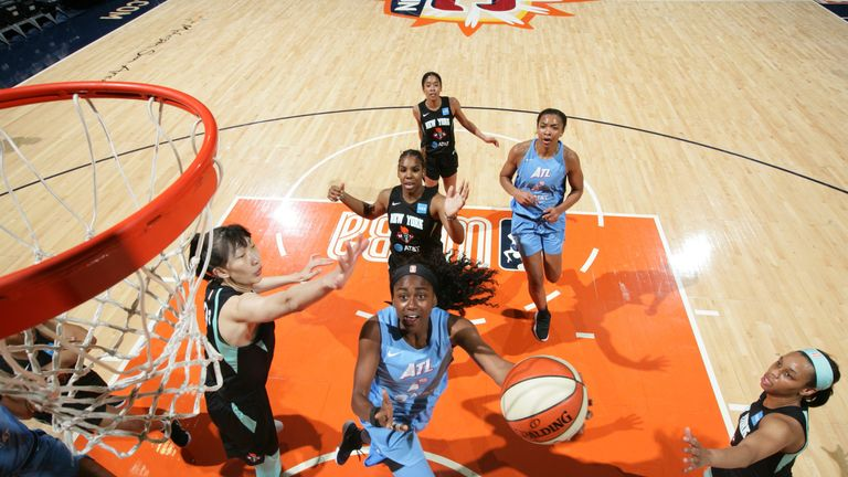 Tiffany Hayes lofts a scoop shot for Atlanta