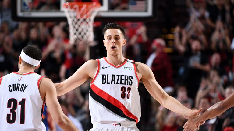 Zach Collins high-fives his Portland team-mates during Game 6