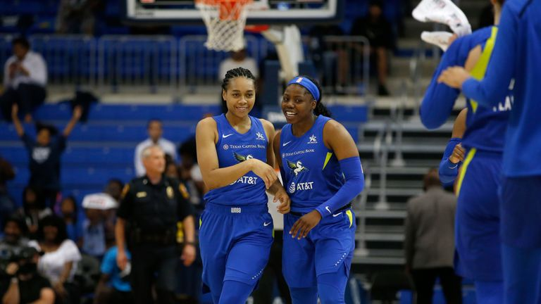 Allisha Gray and Arike Ogunbowale celebrate the Dallas Wings' victory over the Connecticut Sun