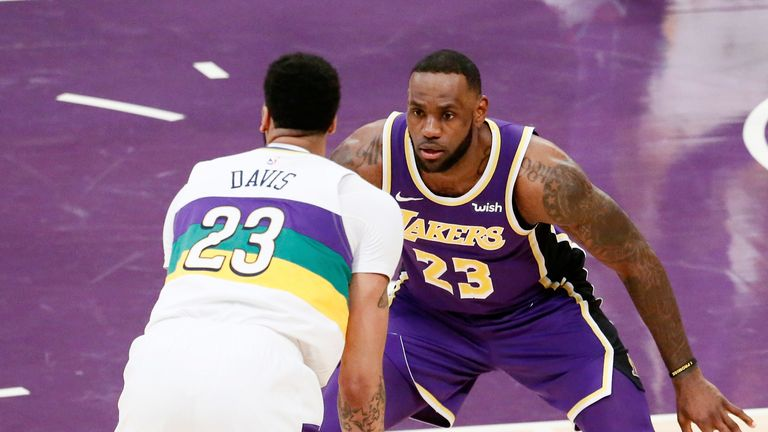 LeBron James faces up Anthony Davis in a 2018/19 regular season game between the Los Angeles Lakers and the New Orleans Pelicans