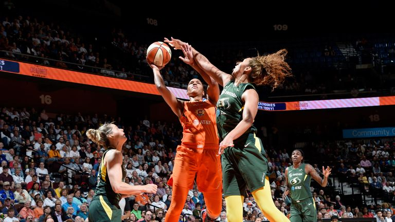 Alyssa Thomas shoots over the Seattle Storm defense