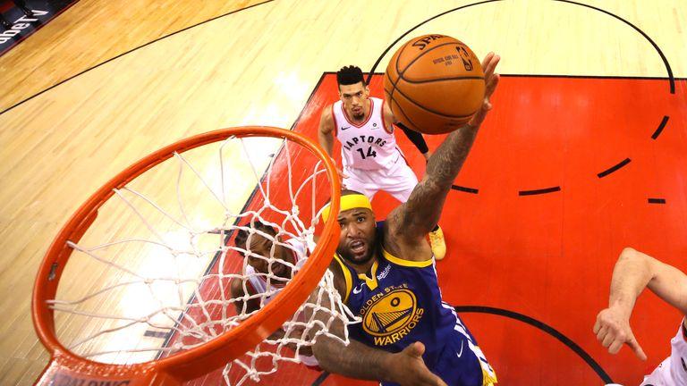 DeMarcus Cousins rises towards the Raptors' basket during Game 2