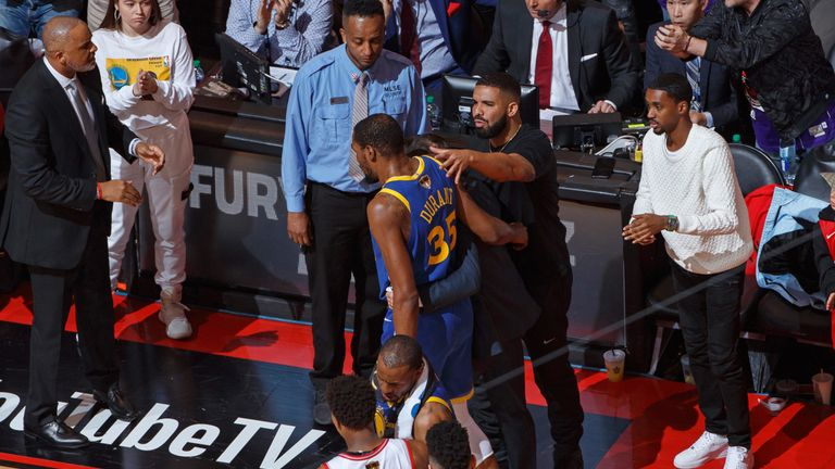 Drake consoles Kevin Durant as the Warriors star leaves Game 5 through injury