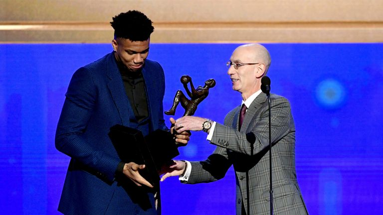 Adam Silver presents Giannis Antetokounmpo with the 2018-19 Most Valuable Player award