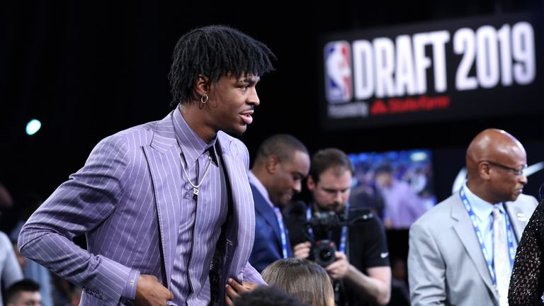 Ja Morant walks to the stage after being taken second in the NBA Draft
