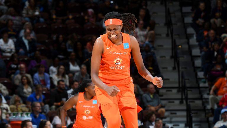 Jonquel Jones celebrates a basket in Connecticut's win over Washington