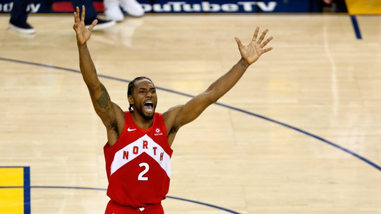 Kawhi Leonard celebrates at the buzzer as the Toronto Raptors complete a 4-2 series victory over the Golden State Warriors in the NBA Finals