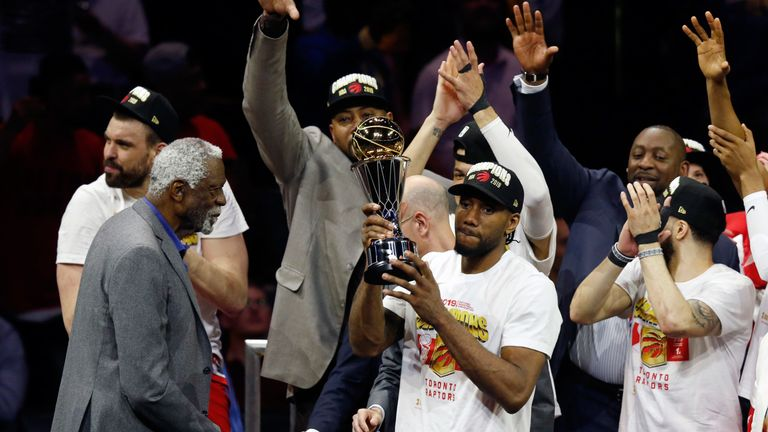 Kawhi Leonard lifts the NBA Finals MVP trophy