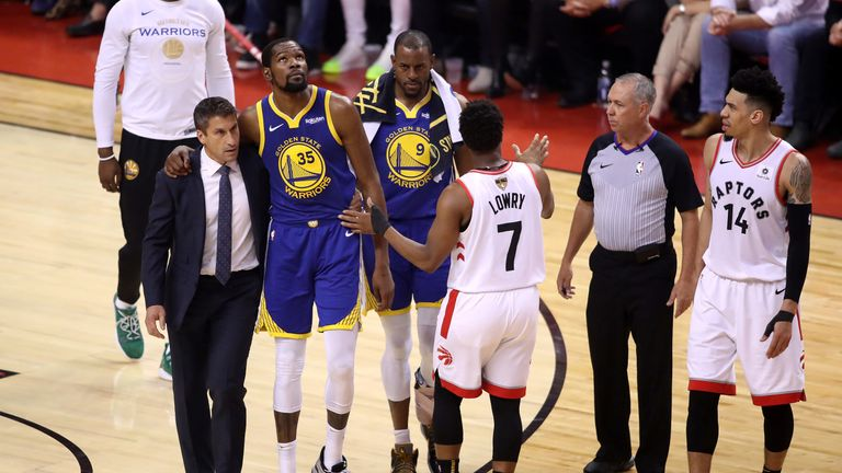 Kevin Durant is helped from the court after suffering an Achilles injury in Game 5 of the NBA Finals