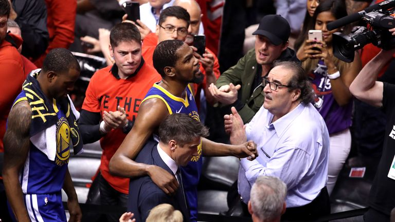 Kevin Durant leaves the court after suffering an Achilles injury in Game 5 of the NBA Finals
