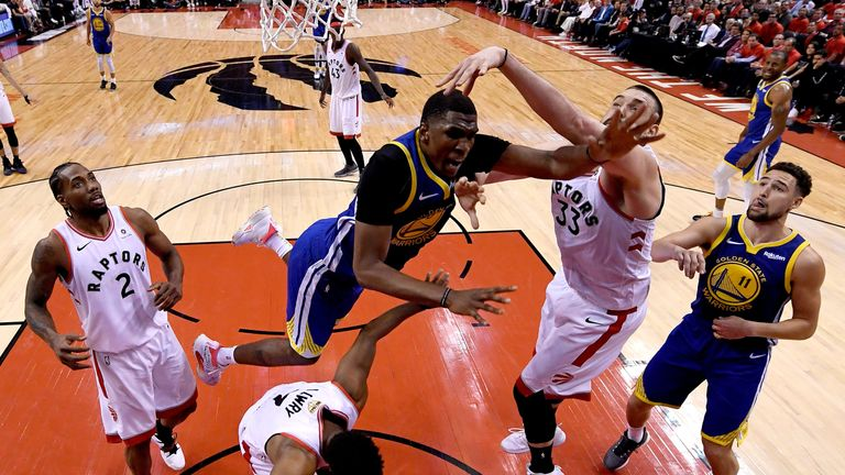 Kevon Looney battles for possession under the basket in Game 5 of the NBA Finals