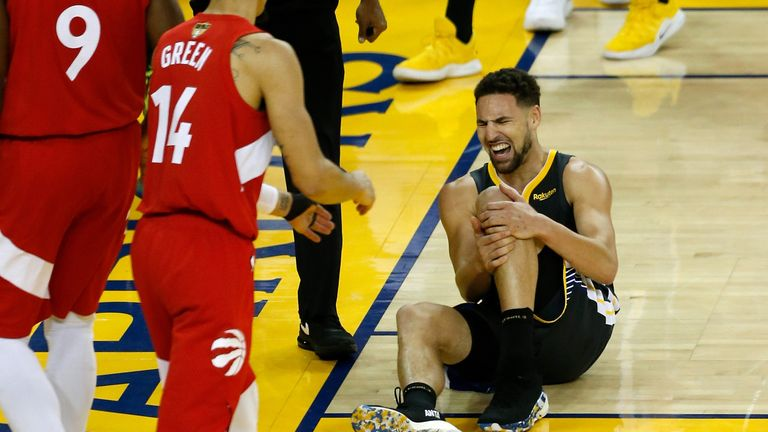 Klay Thompson clutches his knee after being fouled attempting a dunk in Game 6 of the NBA Finals