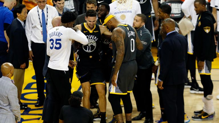Klay Thompson is helped off the court after tearing his ACL in Game 6 of the NBA Finals