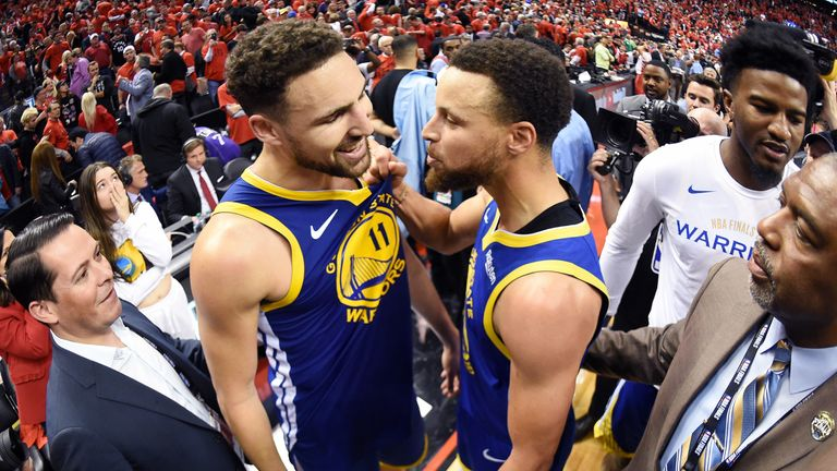 Klay Thompson and Stephen Curry celebrate Golden State's Game 5 win over Toronto