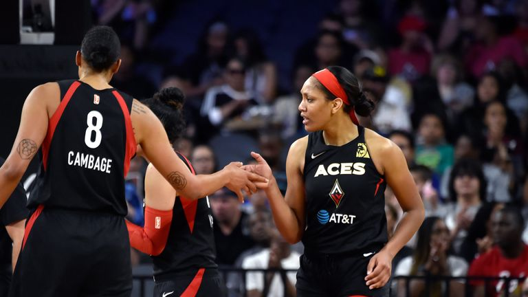 Liz Cambage and A'ja Wilson celebrates a basket in the Aces win over the Storm