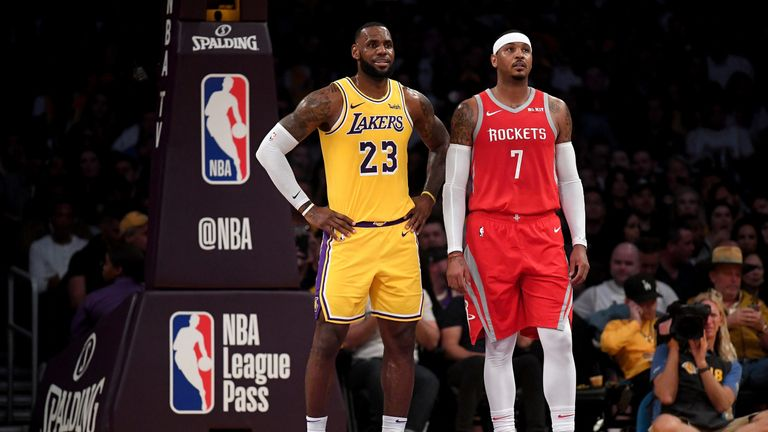 LeBron James and Carmelo Anthony on court in a Lakers-Rockets clash