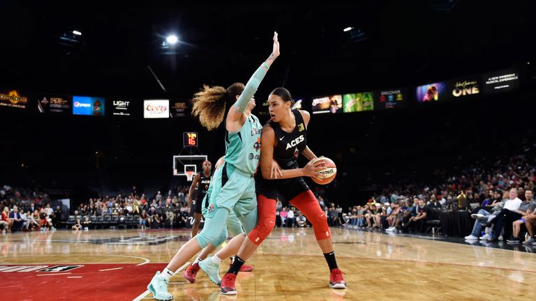 Liz Cambage posts up against the New York Liberty