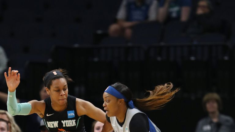 Odyssey Sims drives at the New York Liberty defense