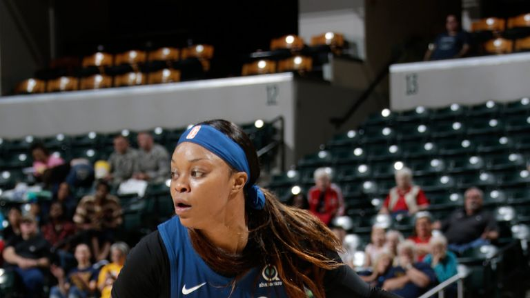 Odyssey Sims probes on offense against the Indiana Fever