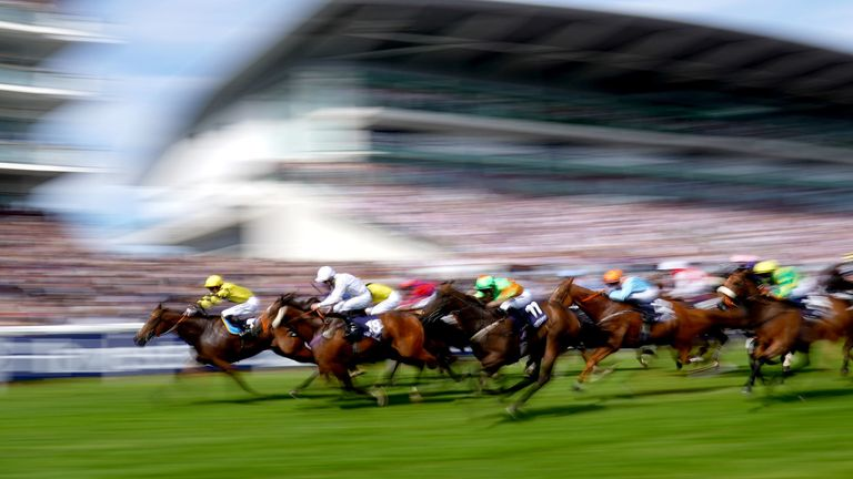 Runners and riders compete in the Investec Dash Handicap during Derby Day of the 2019 Investec Derby Festival at Epsom Racecourse, Epsom. PRESS ASSOCIATION Photo. Picture date: Saturday June 1, 2019. See PA story RACING Epsom. Photo credit should read: John Walton/PA Wire. RESTRICTIONS: Editorial Use only, commercial use is subject to prior permission from The Jockey Club
