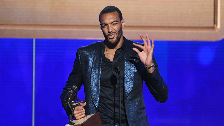 Rudy Gobert celebrates after being named NBA Defensive Player of the Year