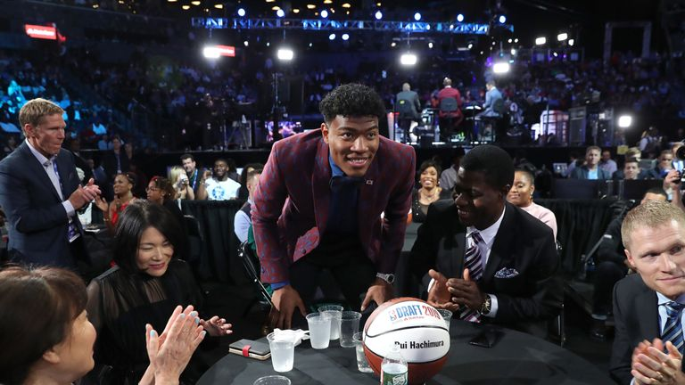 Rui Hachimura bows after being selected by the Washington Wizards