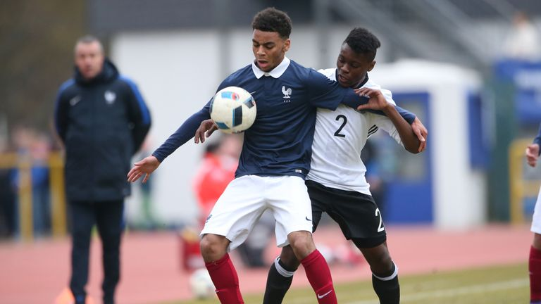 Bote Nzuzi Baku of Germany challenges Alexis Claude-Maurice of France during the friendly match between U18 Germany and U18 France at Saar-Mosel-Stadium on March 24, 2016 in Konz, Germany.