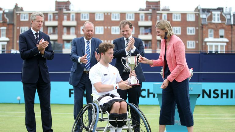 Hewett collects the winners trophy