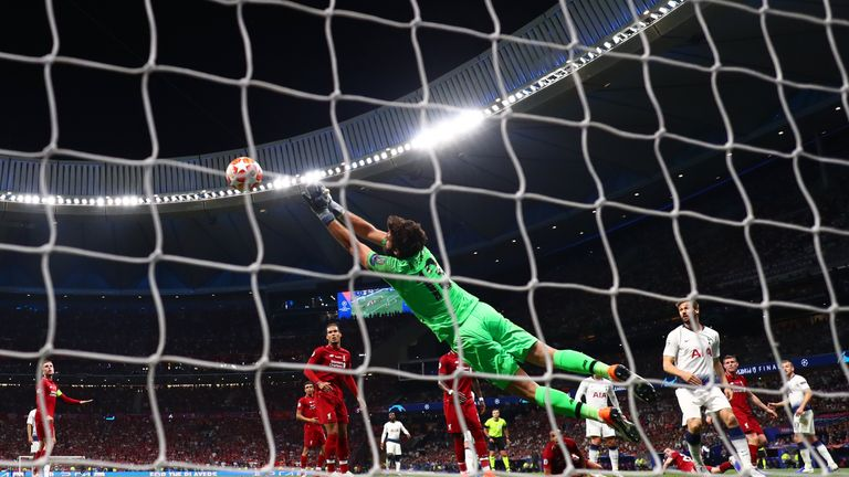 Alisson made a fine late save to keep out Christian Eriksen's free-kick