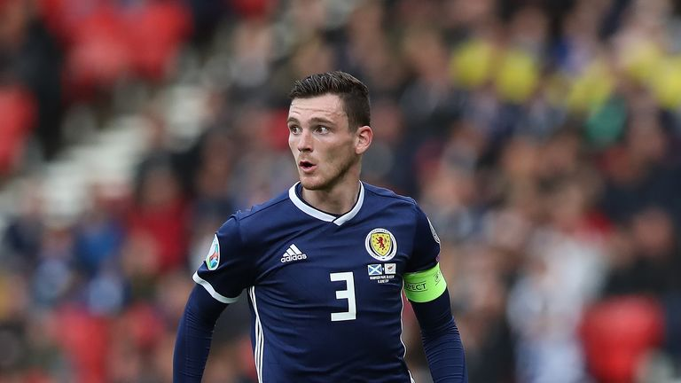Andy Robertson will miss Scotland's game against Belgium
