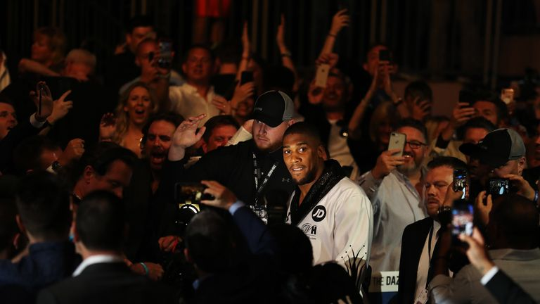 Anthony Joshua appears anxious as he makes his way to the ring at the MSG