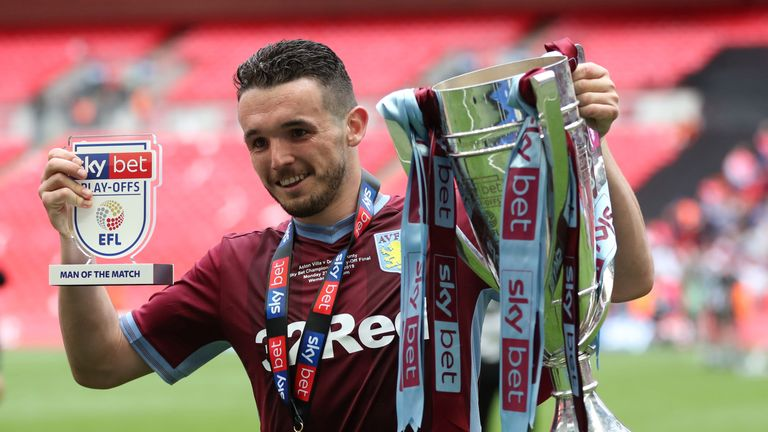 McGinn posing with the play-off trophy at Wembley after scoring a decisive goal in the final