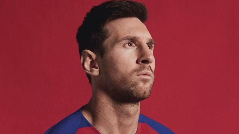 Lionel Messi models Barcelona's new checkerboard kit
