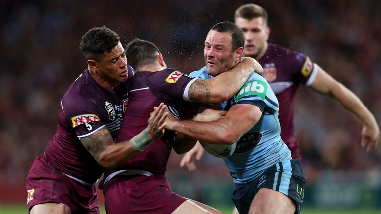 Boyd Cordner of the Blues is tackled during Game I in Brisbane