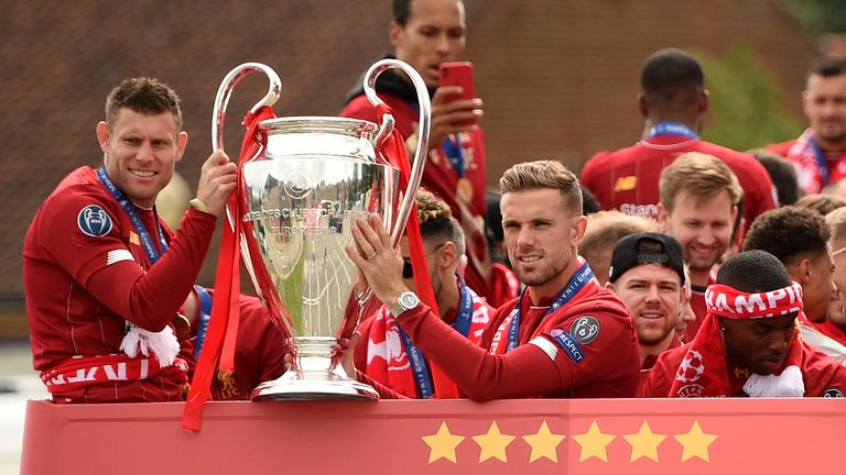 Milner and Henderson show off their new silverware