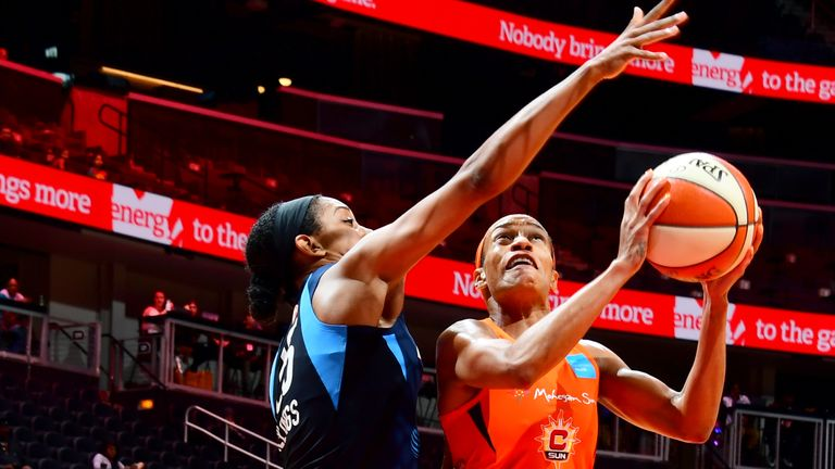 Jasmine Thomas #5 of Connecticut Sun goes to the basket against the Atlanta Dream on June 9, 2019 at the State Farm Arena in Atlanta, Georgia.