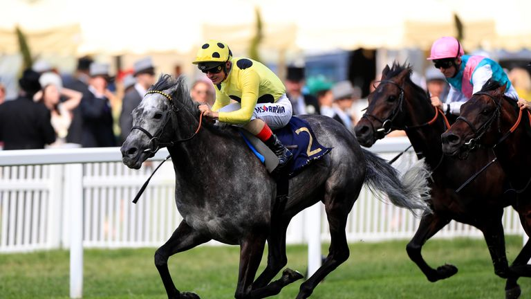 Defoe ridden by jockey Andrea Atzeni on the way to winning the Hardwicke Stakes during day five of Royal Ascot