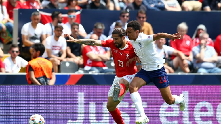 Ricardo Rodriguez of Switzerland battles for possession with Trent Alexander-Arnold of England