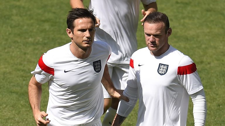 England's midfielder Frank Lampard (L) and forward Wayne Rooney warm up ahead of the Group D football match between Costa Rica and England at The Mineirao Stadium in Belo Horizonte on June 24, 2014,during the 2014 FIFA World Cup . AFP PHOTO / ODD ANDERSEN