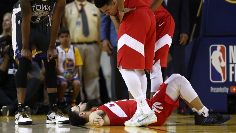 Fred VanVleet lies on the ground after taking an elbow to the forehead in Game 4