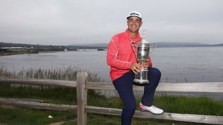 Gary Woodland poses with the US Open trophy after winning on 13 under