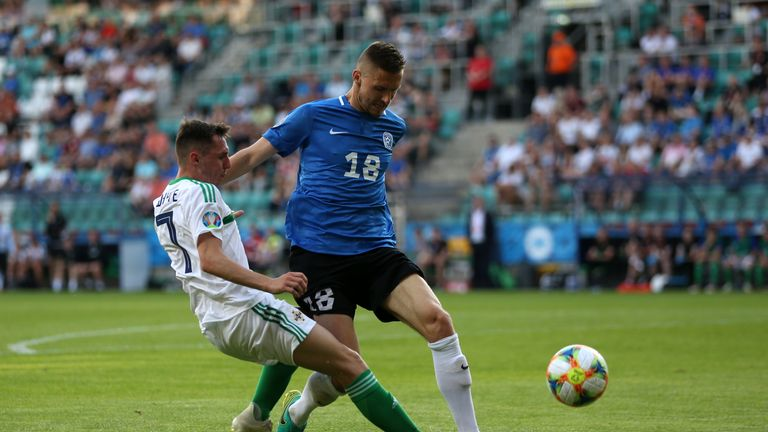 Gavin Whyte (left) and Estonia's Karol Mets battle for the ball