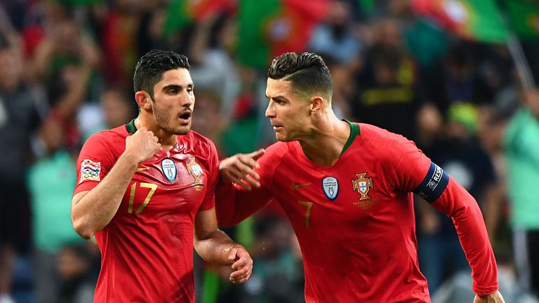 Goncalo Guedes celebrates with Portugal's forward Cristiano Ronaldo after scoring against Netherlands