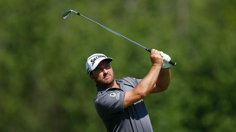 Graeme McDowell birdied the last two holes to cap a 65